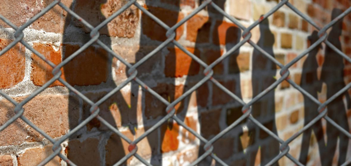Chain-link fence outside a prison exercise yard