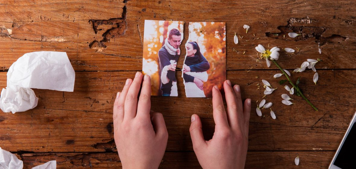 Photo of a couple torn in half
