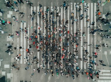Aerial view of a crowd crossing a pedestrian crossing