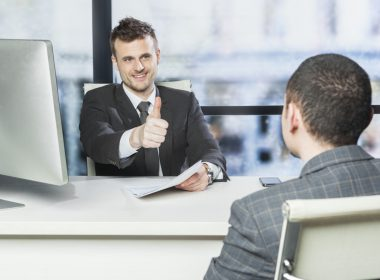 Employee gets thumbs up from manager during performance review